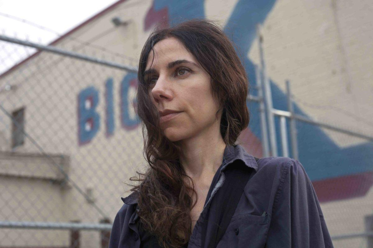 """Community of Hope. PJ Harvey in the centre of Anacostia. Washington DC. USA in April 2014. Anacostia was a place of inspiration for  her album """"Hope Six Demlition Project""""  and """"The Hollow of the Hand"""", a collaborative book of her poetry and photography by Seamus Murphy. The music film """"Community of Hope"""" made by Seamus Murphy was filmed largely in Anacostia and Washington DC"""